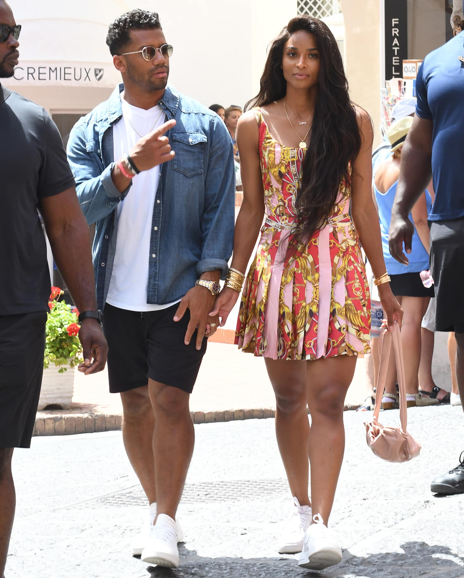 Russell Wilson and Ciara strolling around Capri in Italy for their fifth wedding anniversary on July 8, 2021