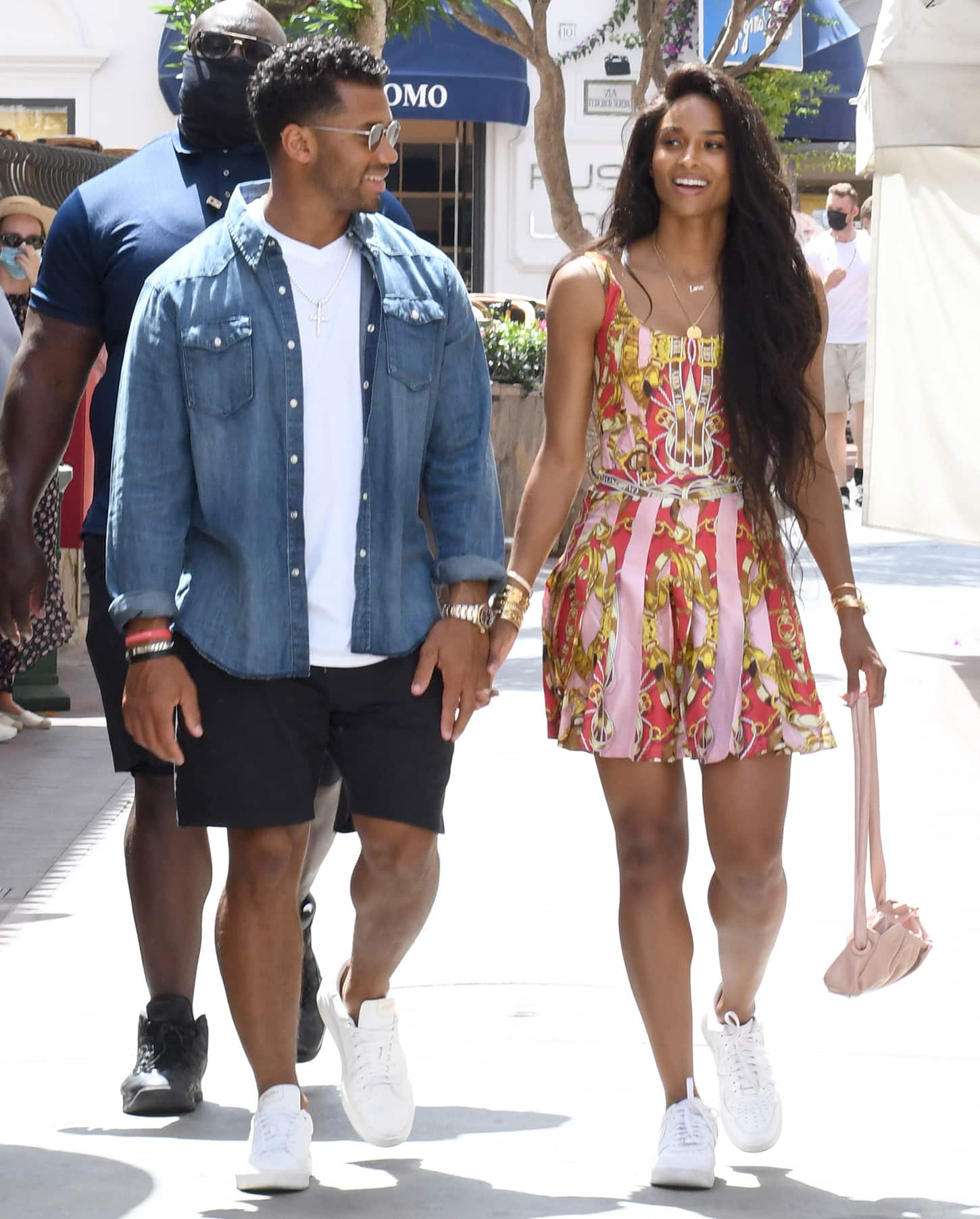 Ciara shows off her toned legs in a chic patterned Moschino mini dress