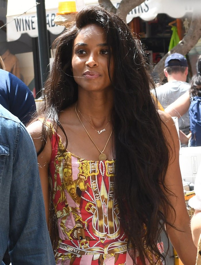 Ciara wears her long natural tresses down and enhances her beauty with minimal makeup