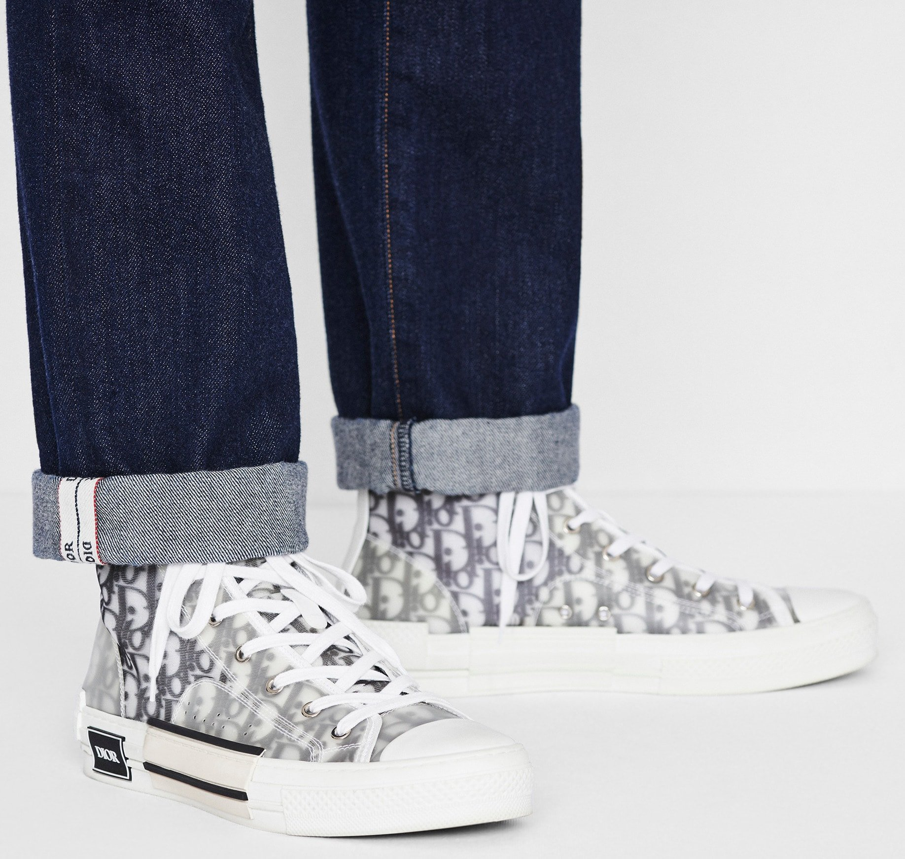 Dior's B23 high-top kicks feature the fashion house's infamous white and black Oblique motif and transparent paneling