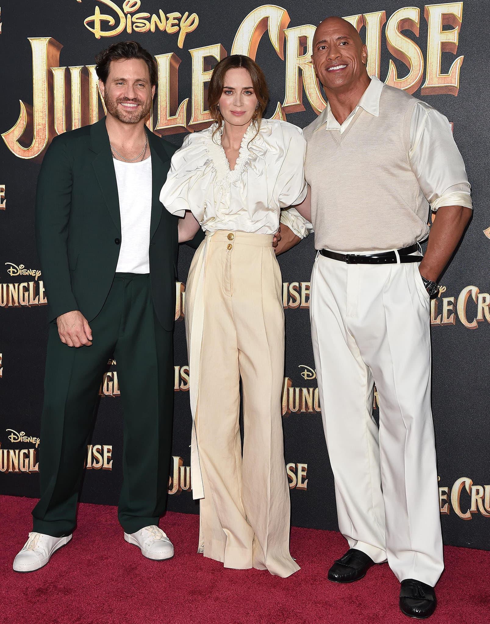 Edgar Ramirez, Emily Blunt, and Dwayne Johnson at the red carpet premiere of Jungle Cruise movie at Disneyland's Fantasyland Theater