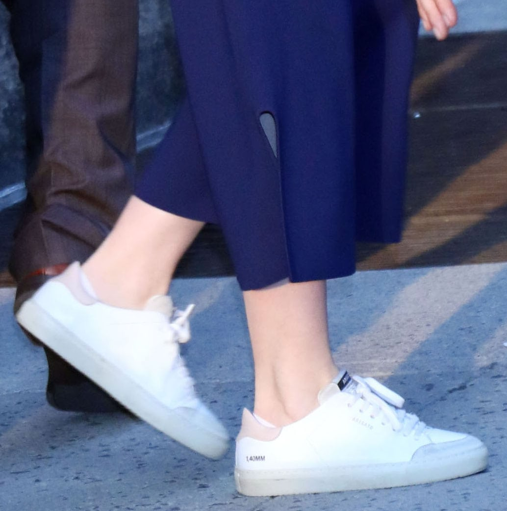 Emily Blunt adds sporty edge to her chic look with Axel Arigato Clean 90 Triple sneakers