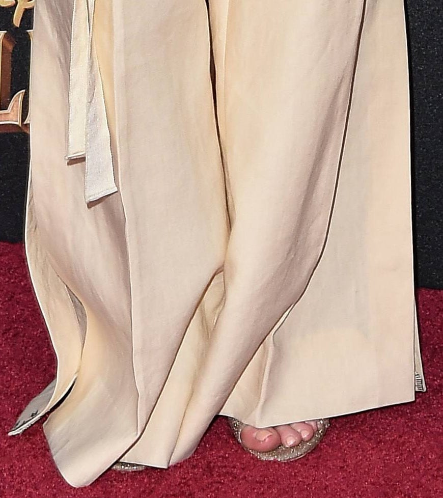 Emily Blunt pairs her loose-fitting pants with Christian Louboutin glittery open-toe sandals
