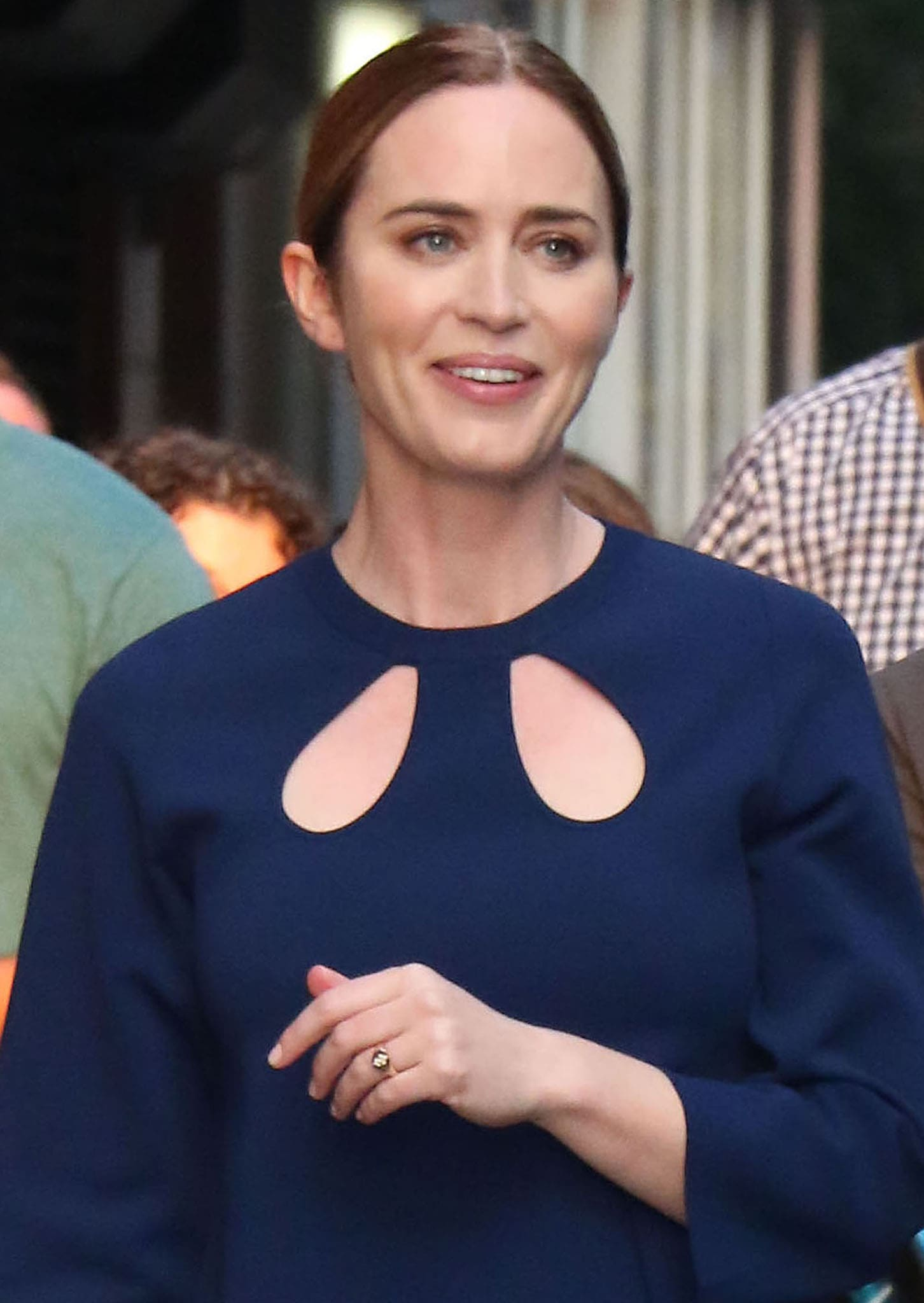 Emily Blunt keeps things simple with a neat hair bun and peachy makeup