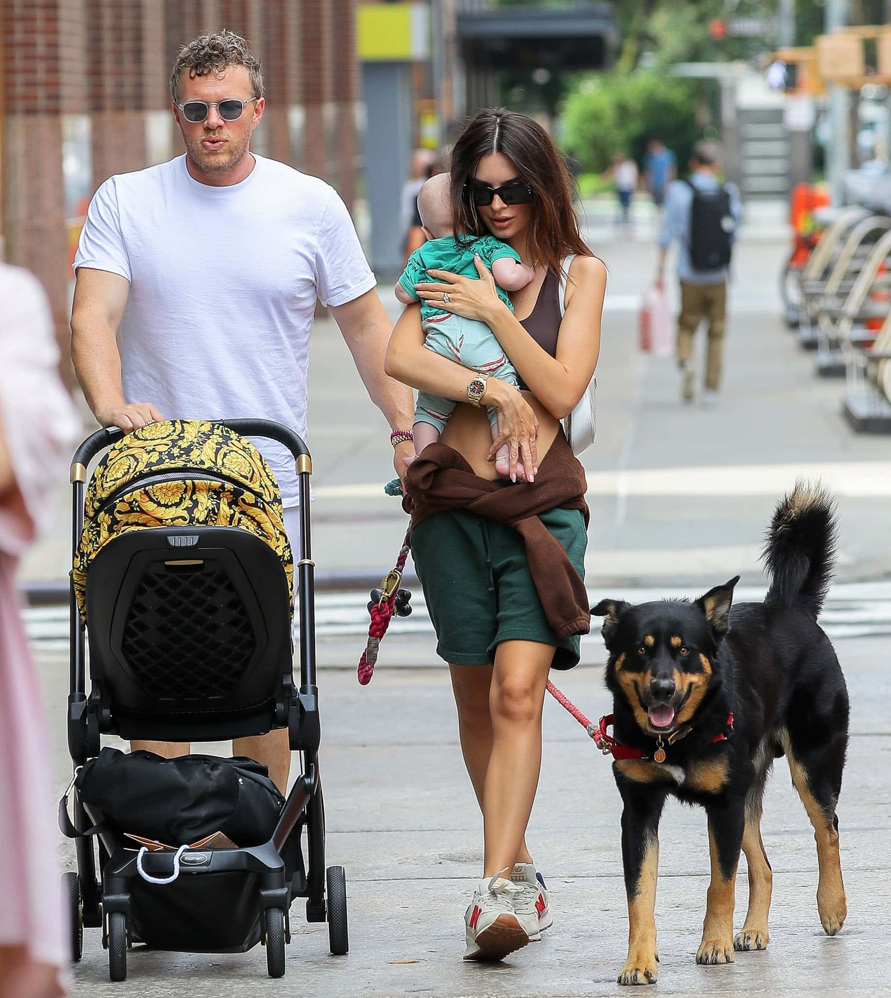 Sebastian Bear-McClard and Emily Ratajkowski take their son Sylvester and dog Colombo out in New York City on July 10, 2021