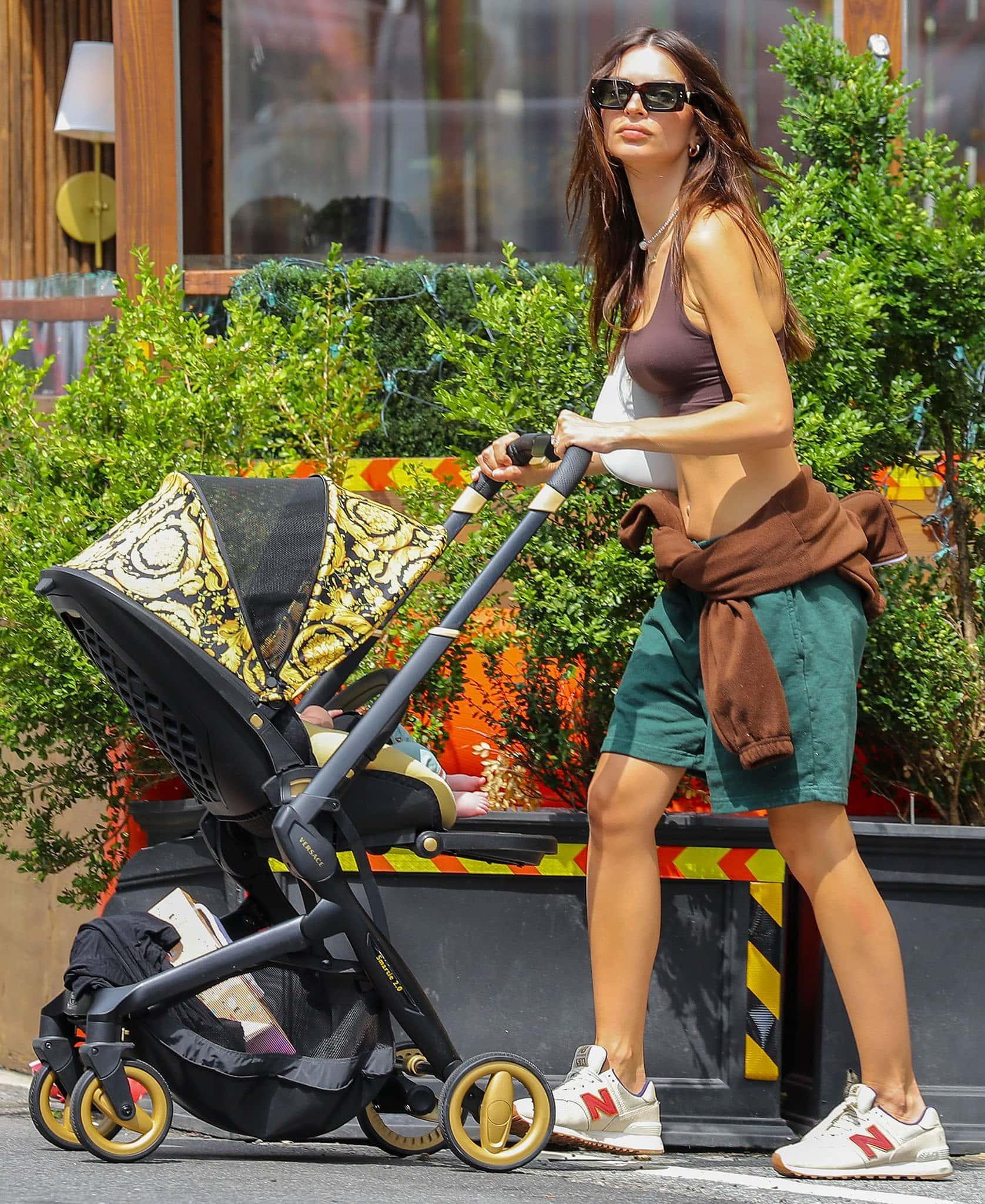 Emily Ratajkowski pushes her son's Versace Barocco stroller