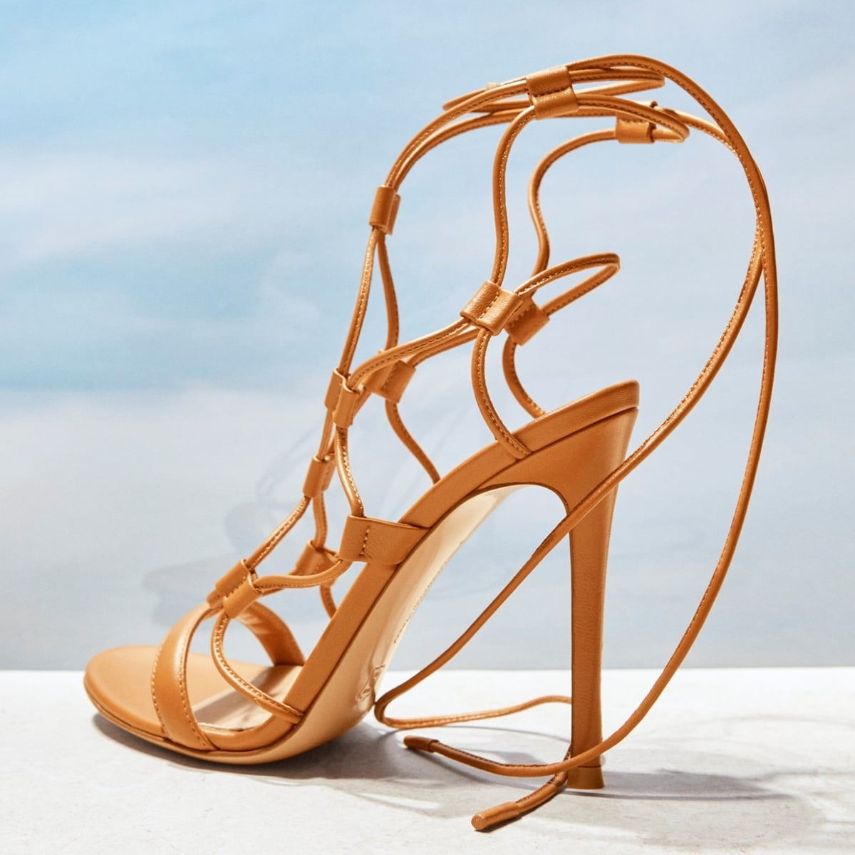 These summer sandals have been handmade in Italy from smooth leather and artfully braided into a lattice