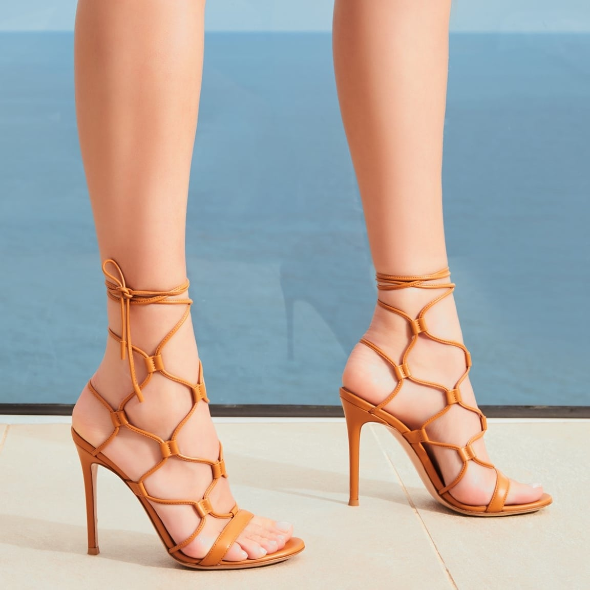 Gianvito Rossi's Giza sandals trace elegant curves along the arches of your feet