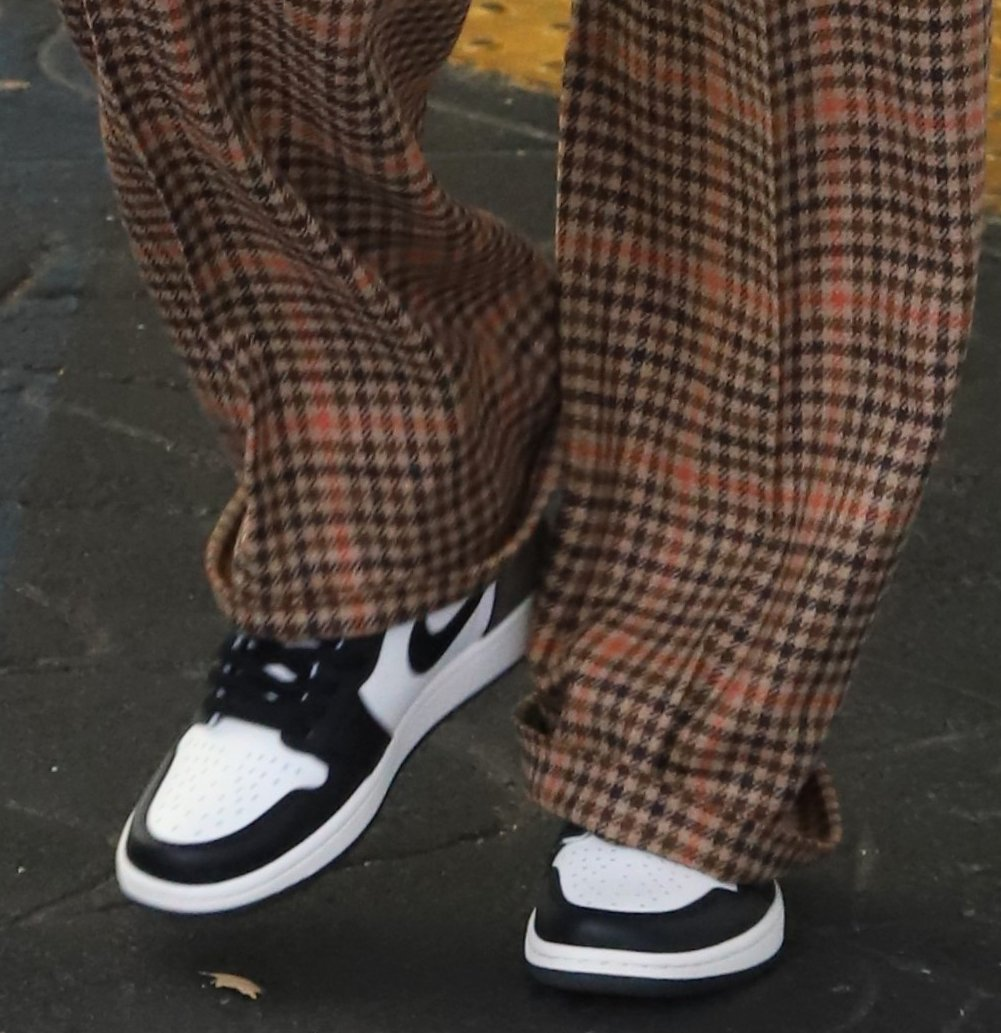 Hailey Bieber gives her chic outfit a touch of sporty vibe with Nike Air Jordan 1 High in Dark Mocha