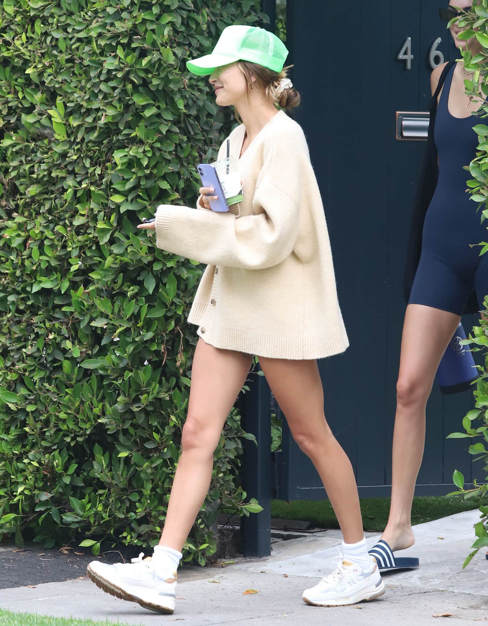 Hailey Bieber embraces the pantless trend in a loose-fitting Nanusha cardigan