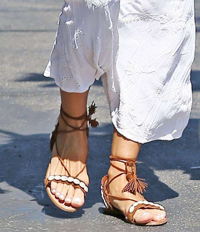 Heidi Klum completes her summery bohemian look with Aquazzura Riviera shell-embellished flat sandals