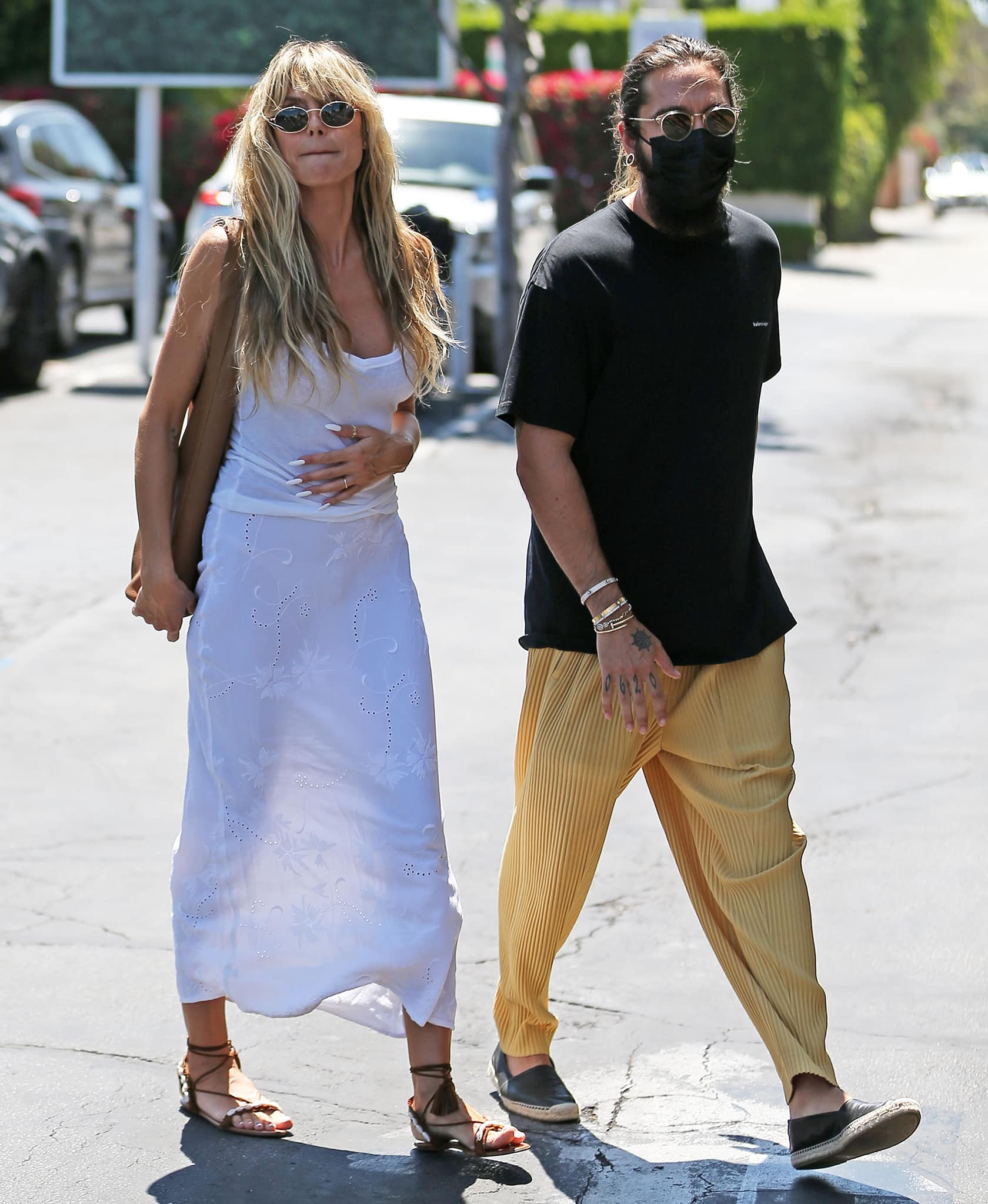 Heidi Klum's husband opts for a casual black tee with yellow pleated pants and espadrille loafers
