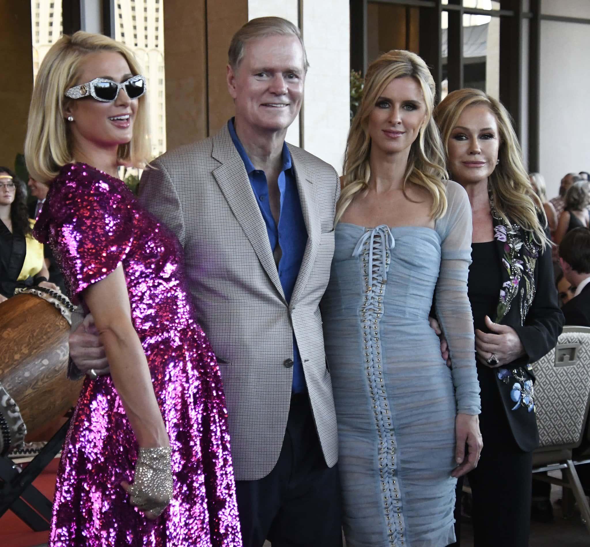 The Hilton family: Paris Hilton, Richard Hilton, Nicky Hilton, and Kathy Hilton pose together at the grand opening of Resorts World Las Vegas