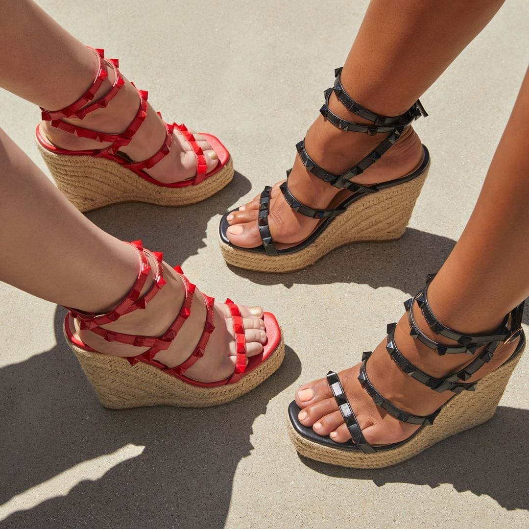 Red and black strappy espadrille wedge with a side buckle closure