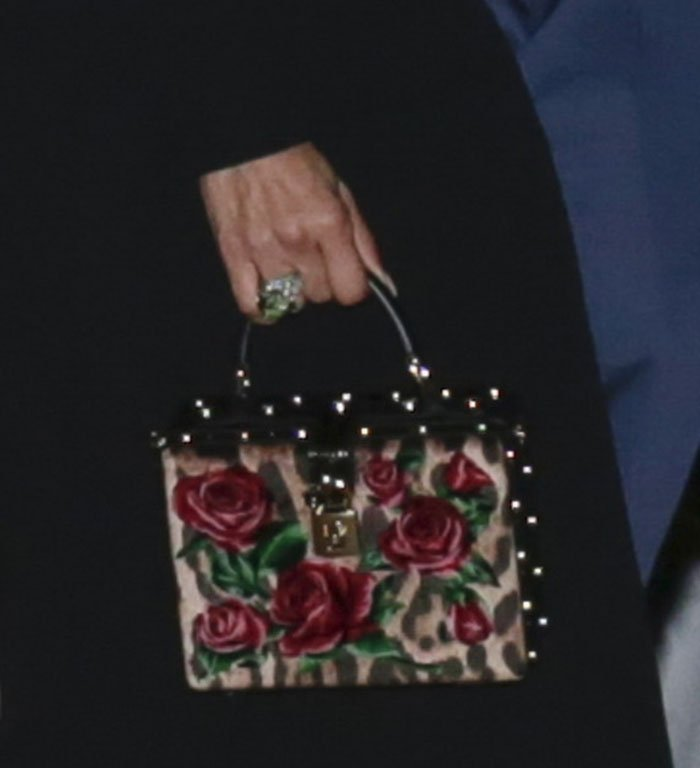 Jennifer Lopez carries her night essentials in a Dolce & Gabbana leopard and floral velvet box bag