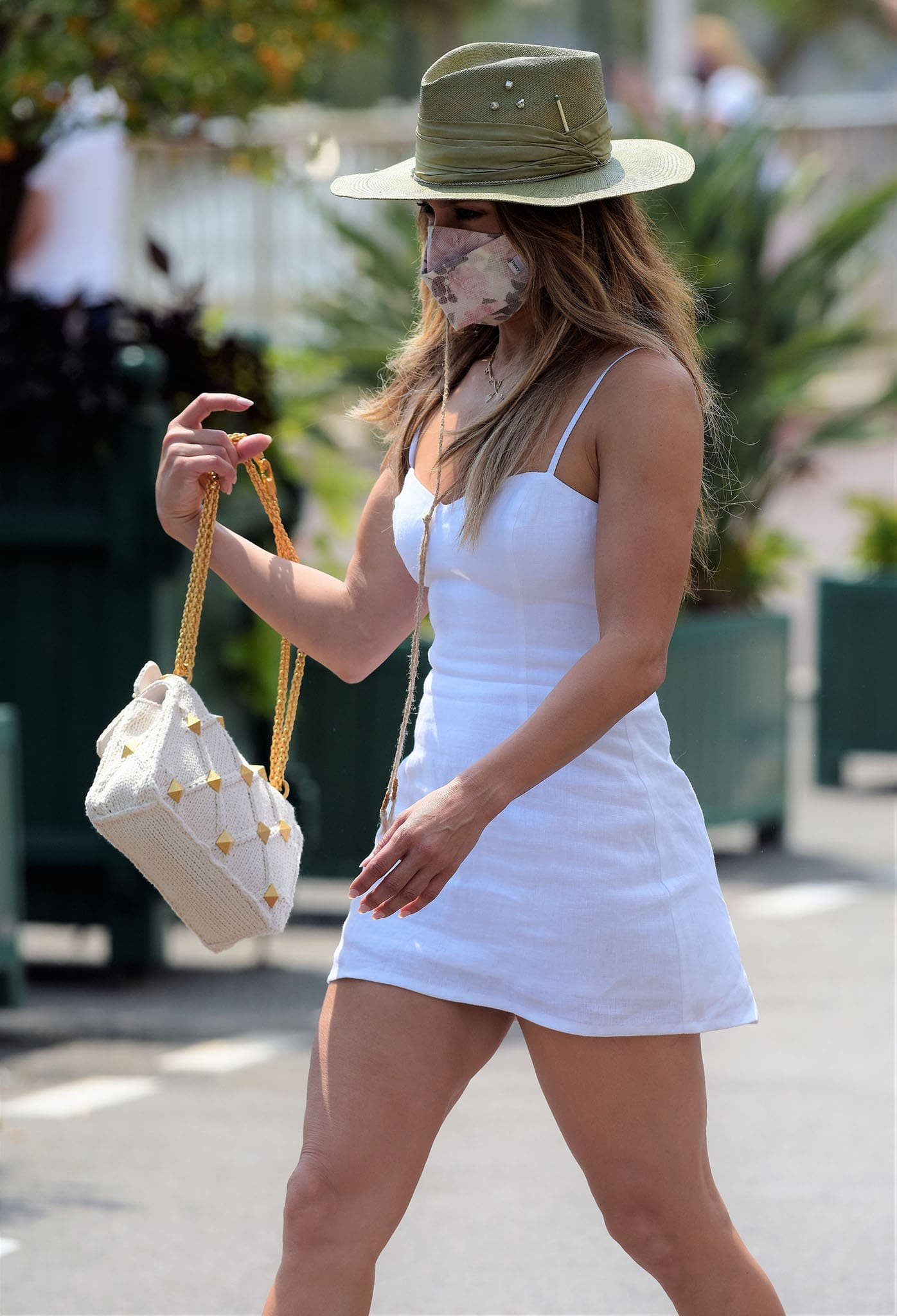 Jennifer Lopez flaunts her incredibly toned figure in a white Reformation mini dress with spaghetti straps