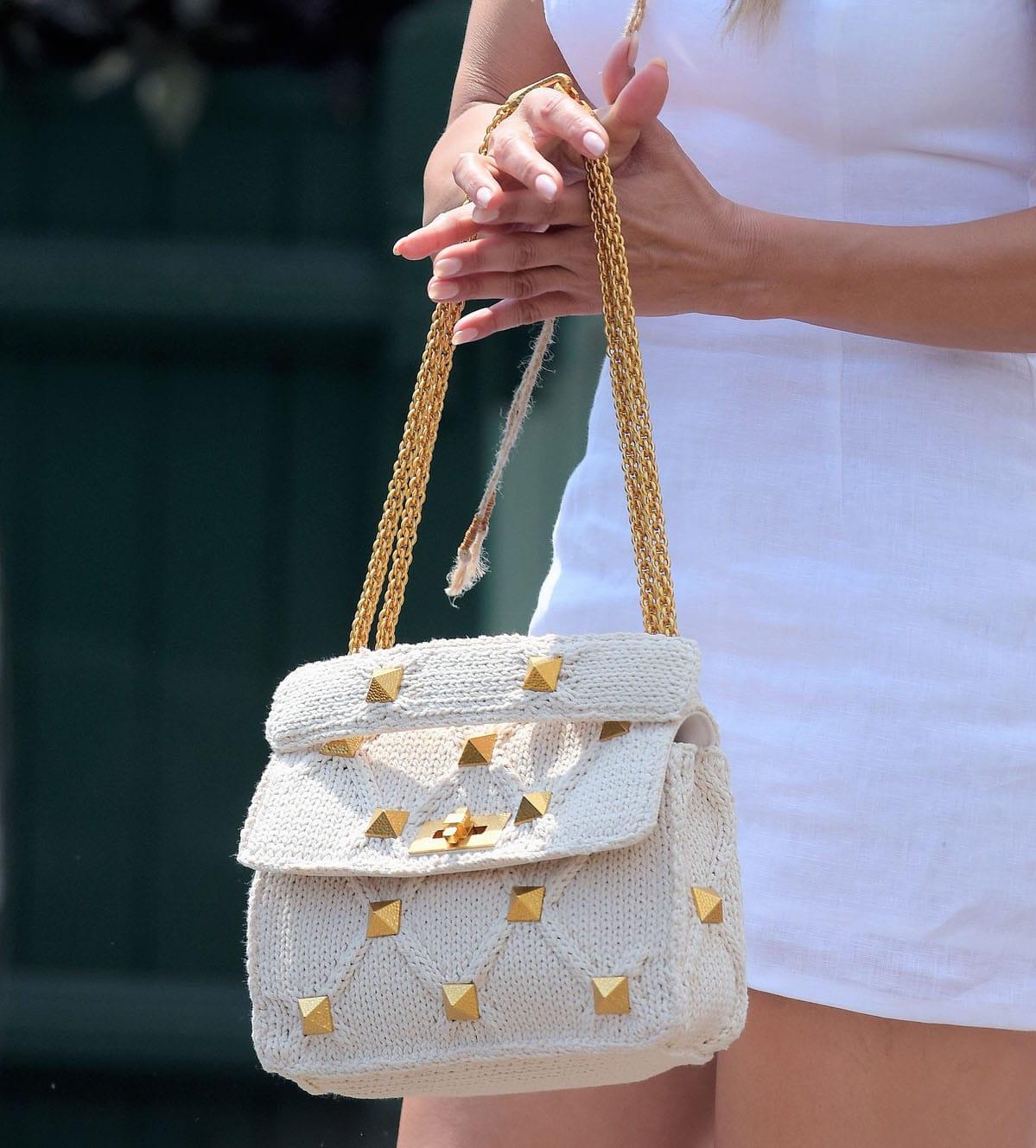 Jennifer Lopez pairs her summery white dress with Valentino Garavani Roman Stud crochet bag