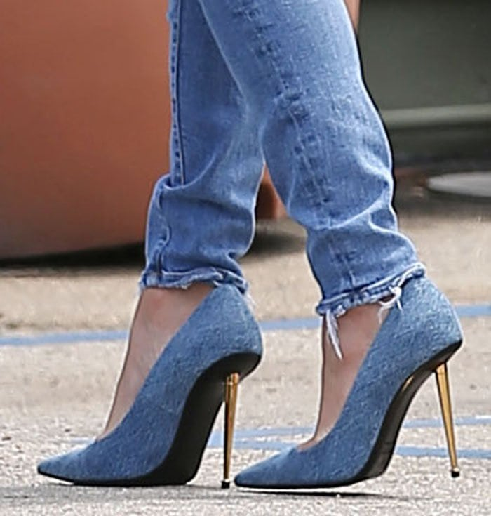 Jennifer Lopez teams her jeans with matching blue suede pumps with gold stiletto heels