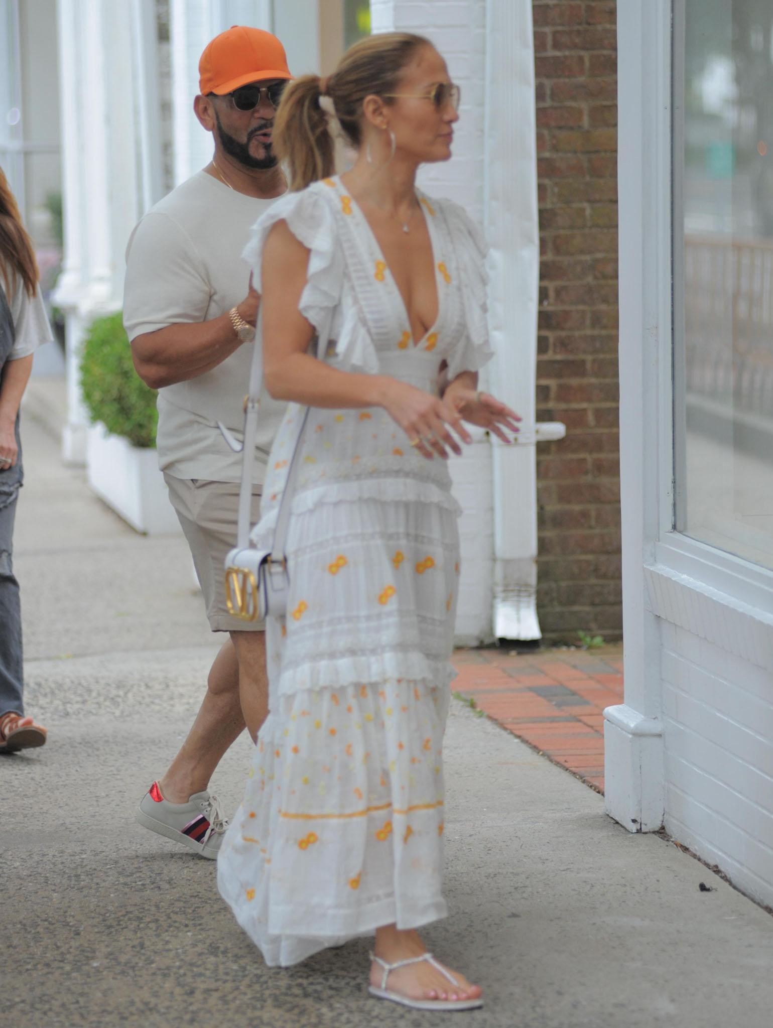 Jennifer Lopez shops in East Hampton in LoveShackFancy white embroidered maxi dress on July 5, 2021