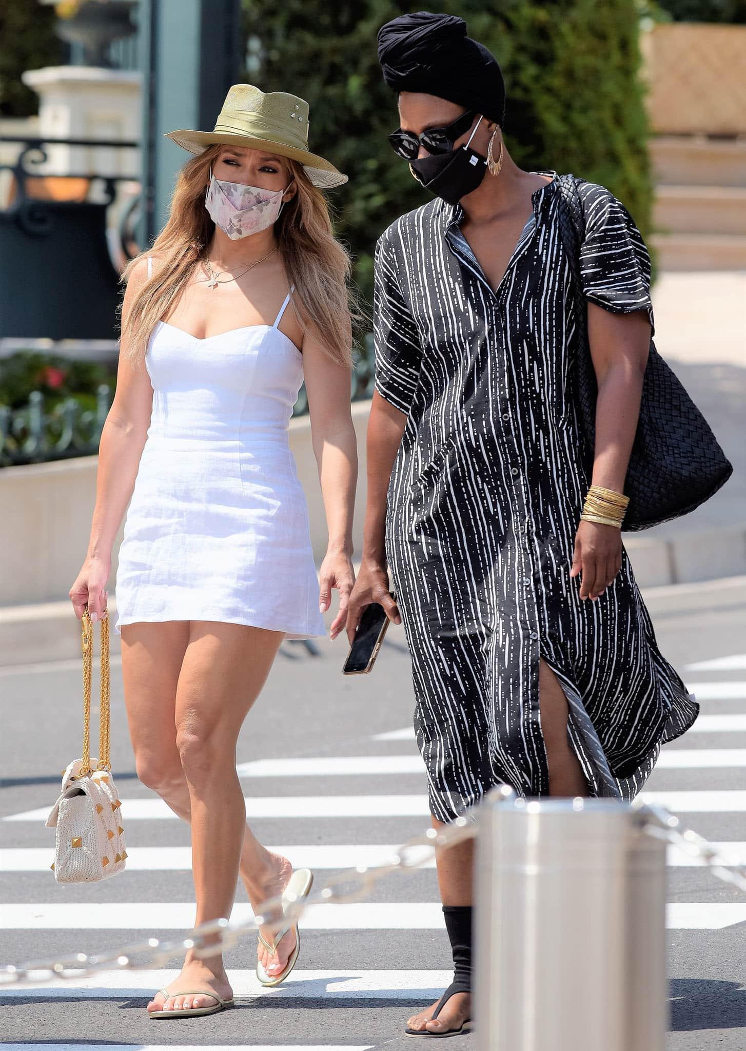 Jennifer Lopez goes shopping with a friend in Monaco on July 26, 2021