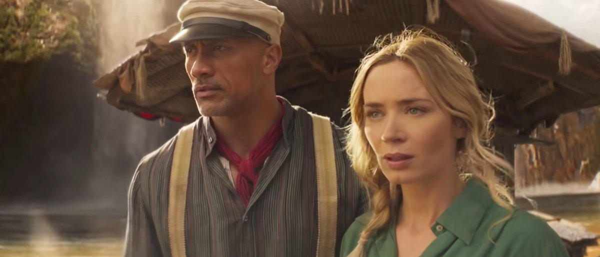 """Dwayne Johnson as """"Skipper"""" Frank Wolff and Emily Blunt as Dr. Lily Houghton in Jungle Cruise"""