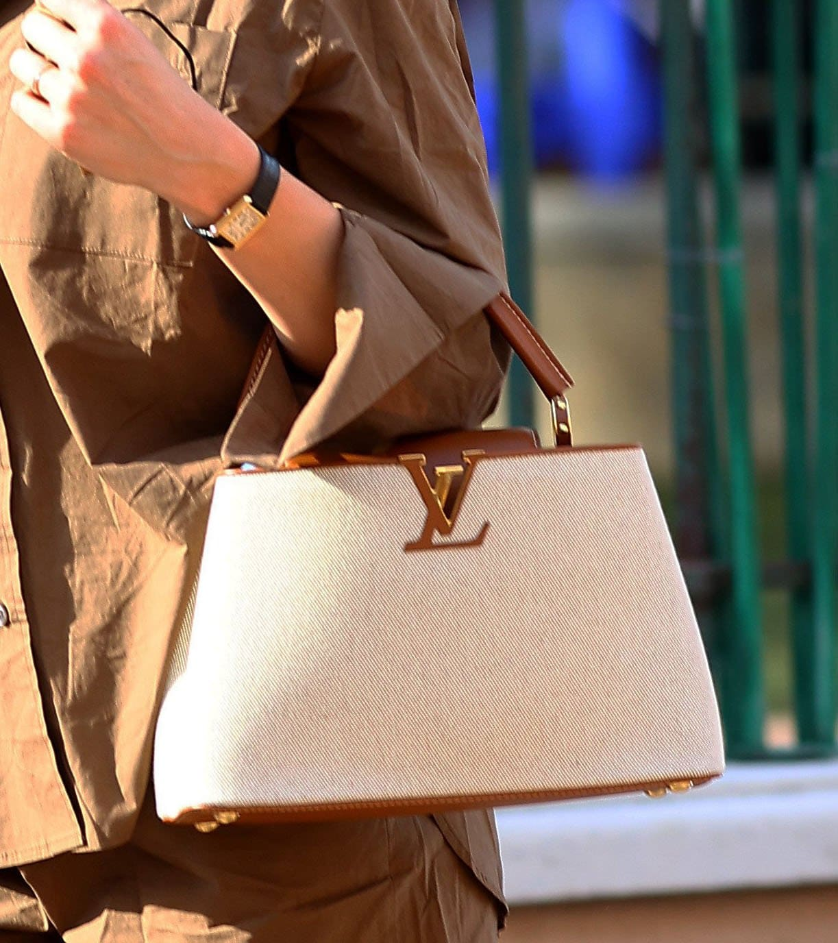 Karlie Kloss carries her stuff in a Louis Vuitton Capucines MM canvas bag