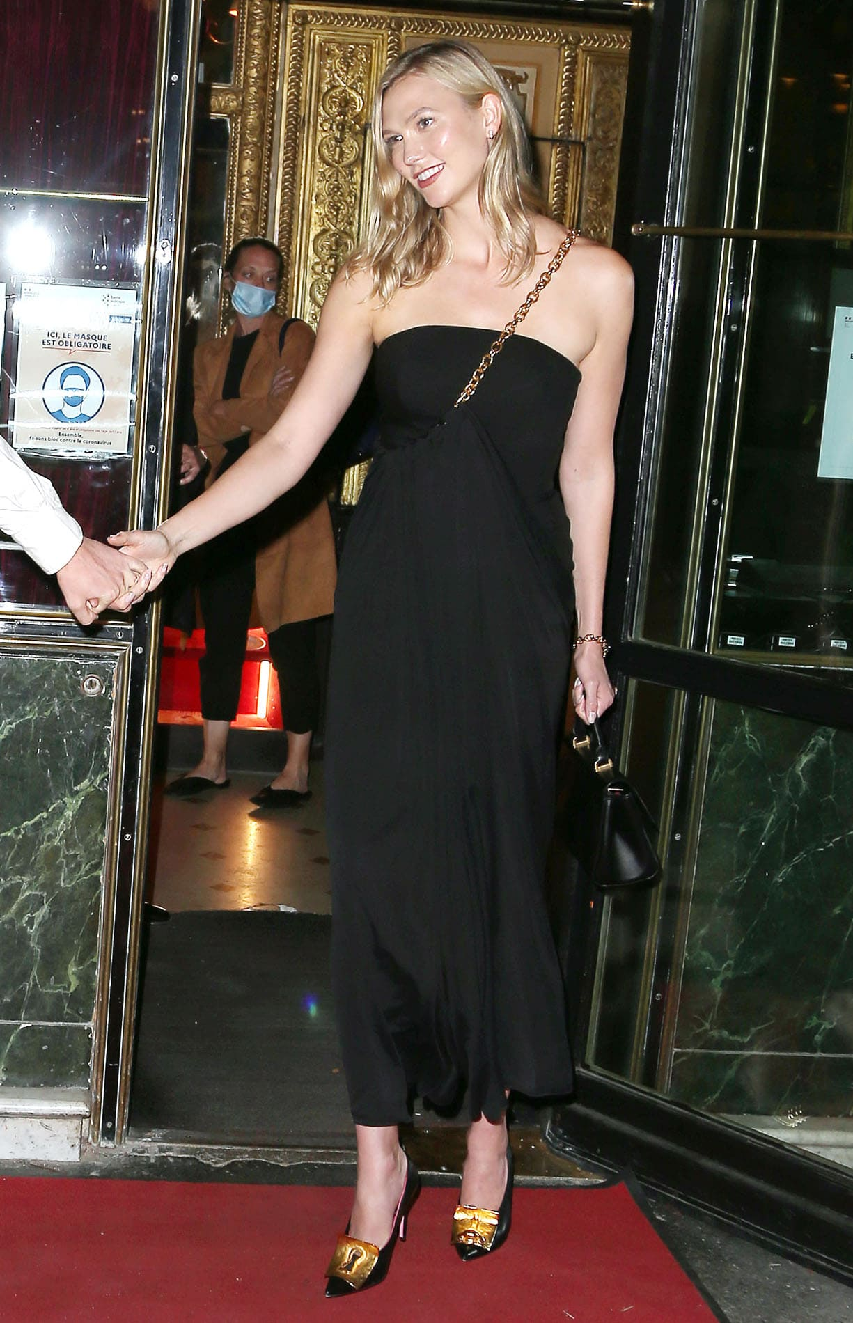 Karlie Kloss wears a Schiaparelli Spring/Summer 2021 black bustier dress