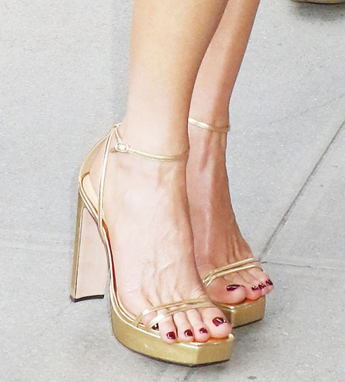 Kate Beckinsale pairs her white dress with Alexandre Birman Lenny gold platform sandals