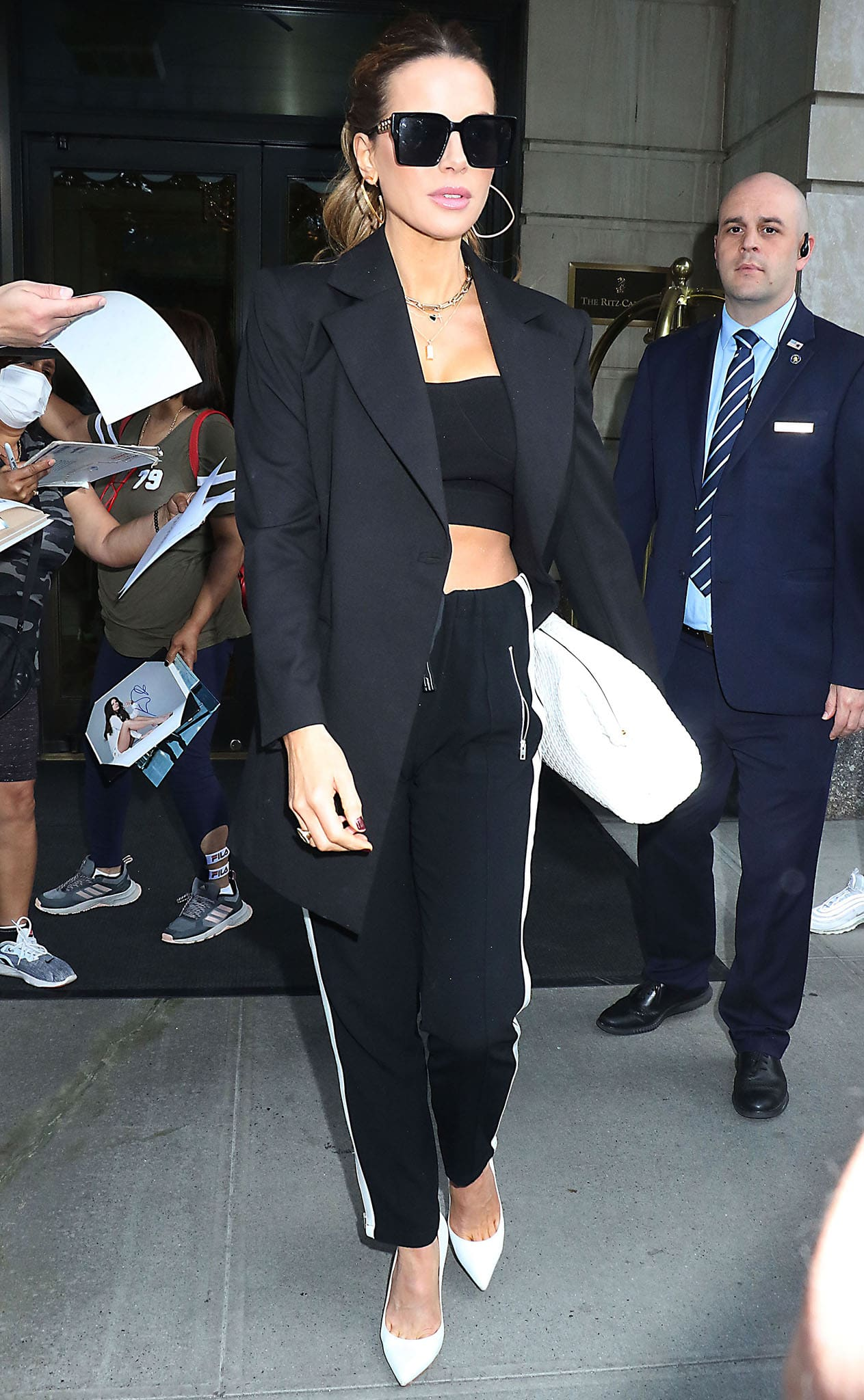 Kate Beckinsale shows off her abs in a black bandeau top with black jogger pants