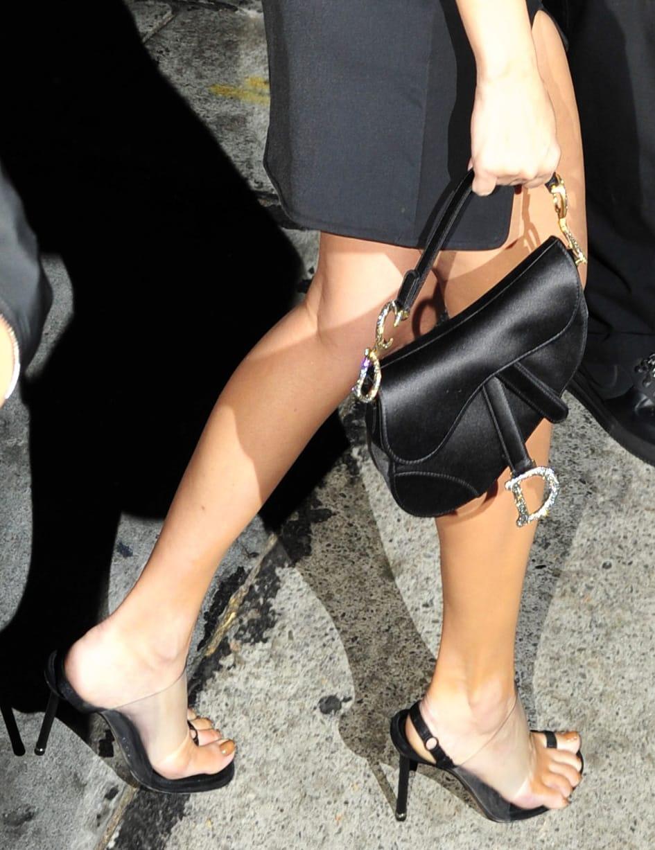 Kourtney Kardashian styles her date-night look with Dior saddlebag and Alexander Wang Kaia sandals