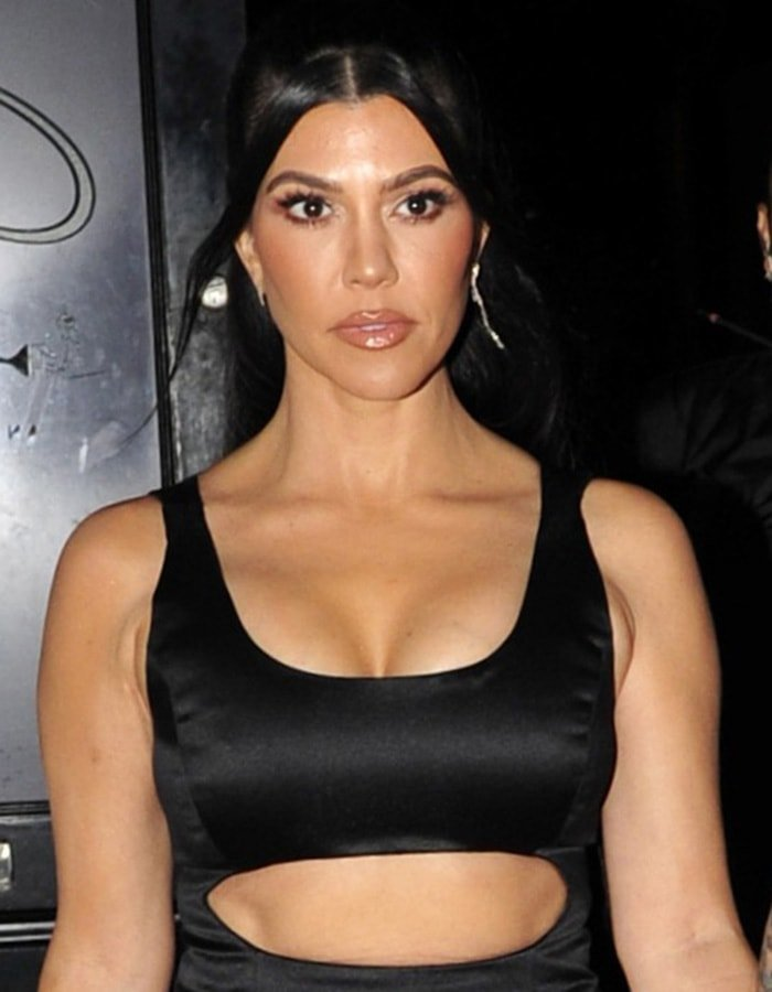 Kourtney Kardashian pulls her long tresses into a high ponytail and wears her signature nude lip gloss with black mascara