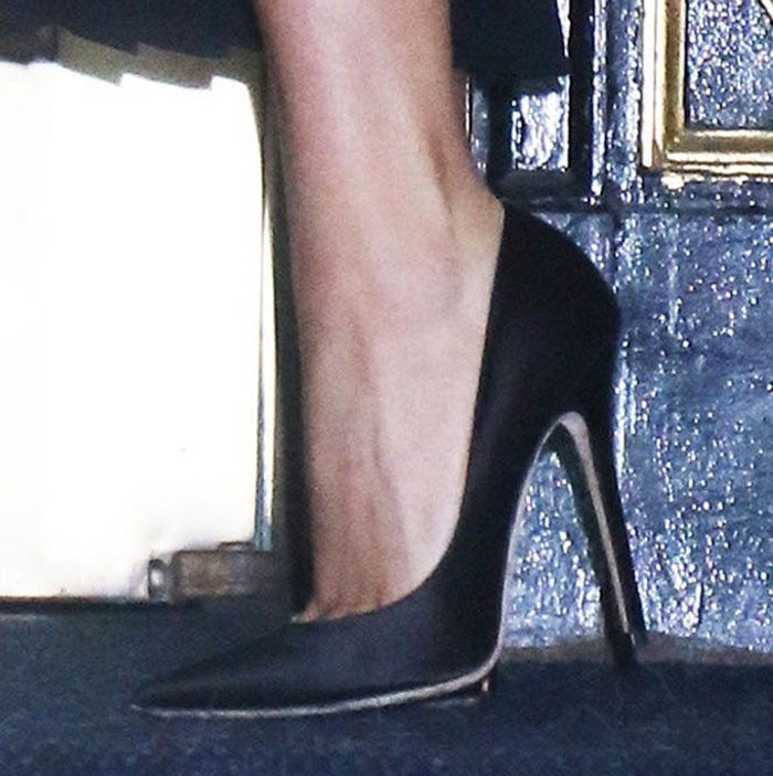 Lady Gaga trades her signature platform shoes for a classic pair of pointy black pumps