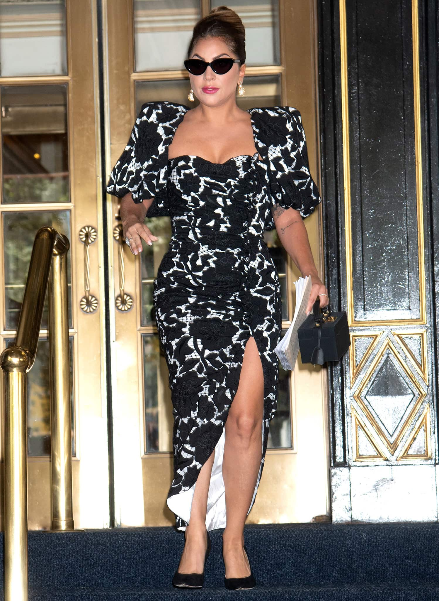 Lady Gaga steps out of her NYC hotel in an '80s-style gown on June 30, 2021