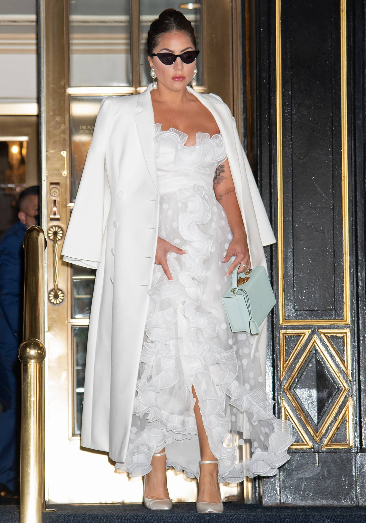 Lady Gaga exits Plaza Hotel in bridal white gown on July 1, 2021