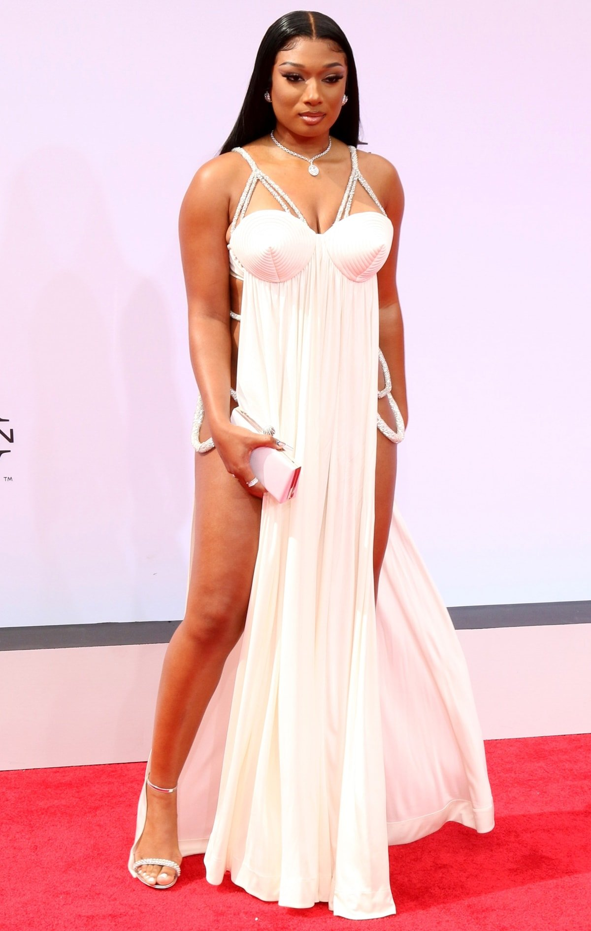 Megan Thee Stallion in a Jean Paul Gaultier dress and Bvlgari jewelry while carrying a Jimmy Choo bag at the 2021 BET Awards