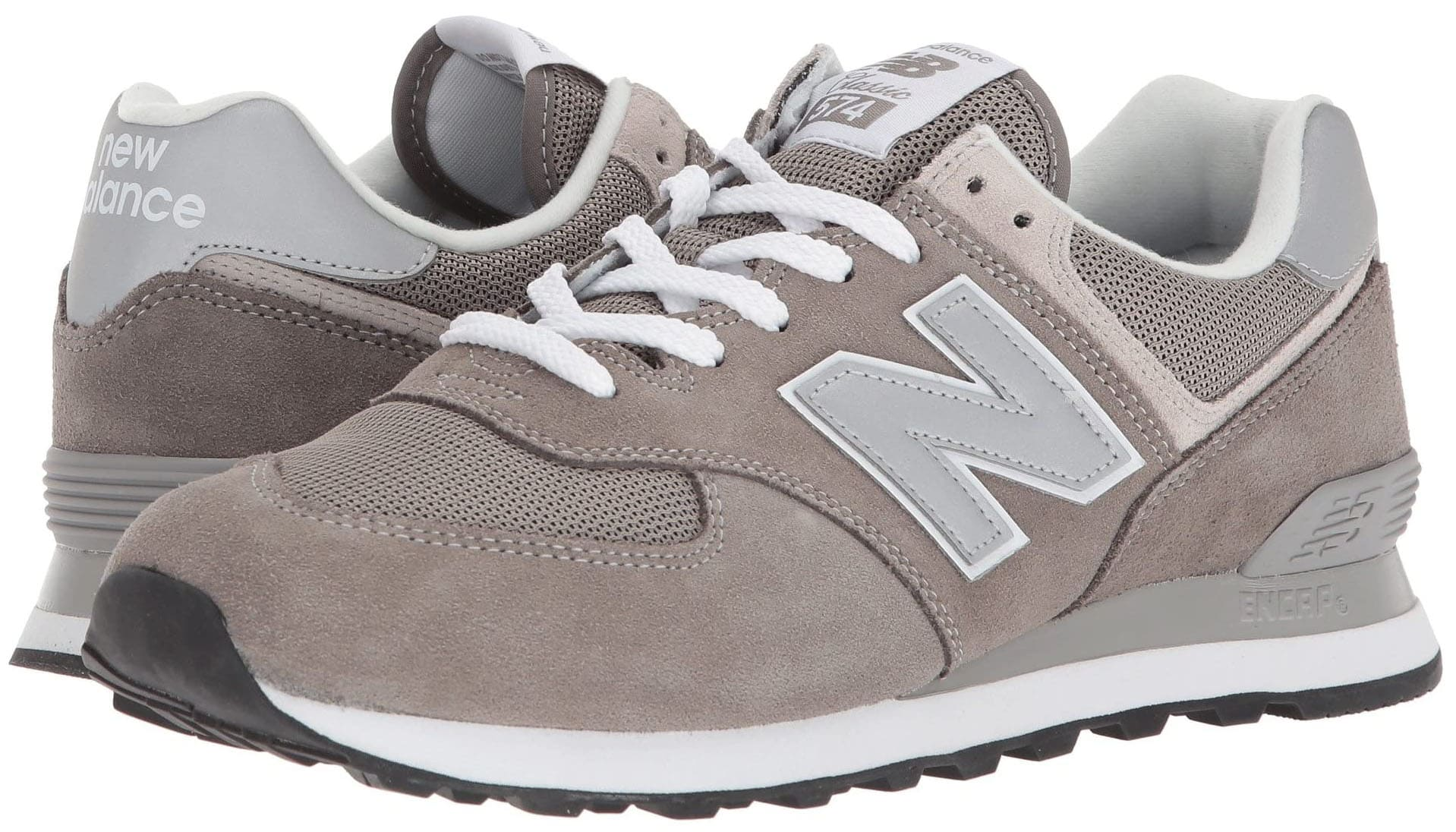 A vintage casual-runner shoe featuring New Balance's iconic 574 silhouette in suede and mesh upper