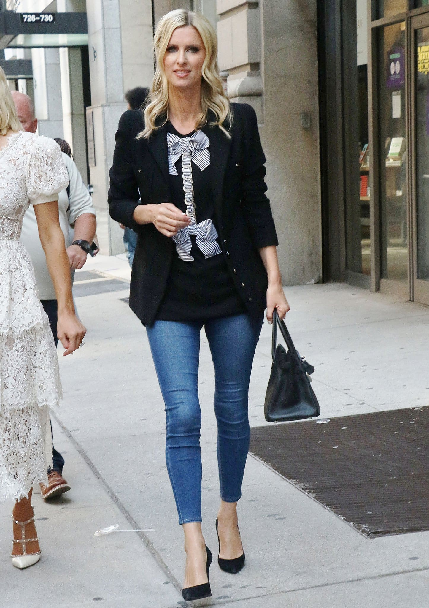 Nicky Hilton opts for casual skinny jeans with Chanel bow-detailed top and blazer