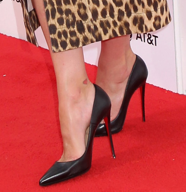 Nicky Hilton teams her dress with classic Christian Louboutin So Kate pumps