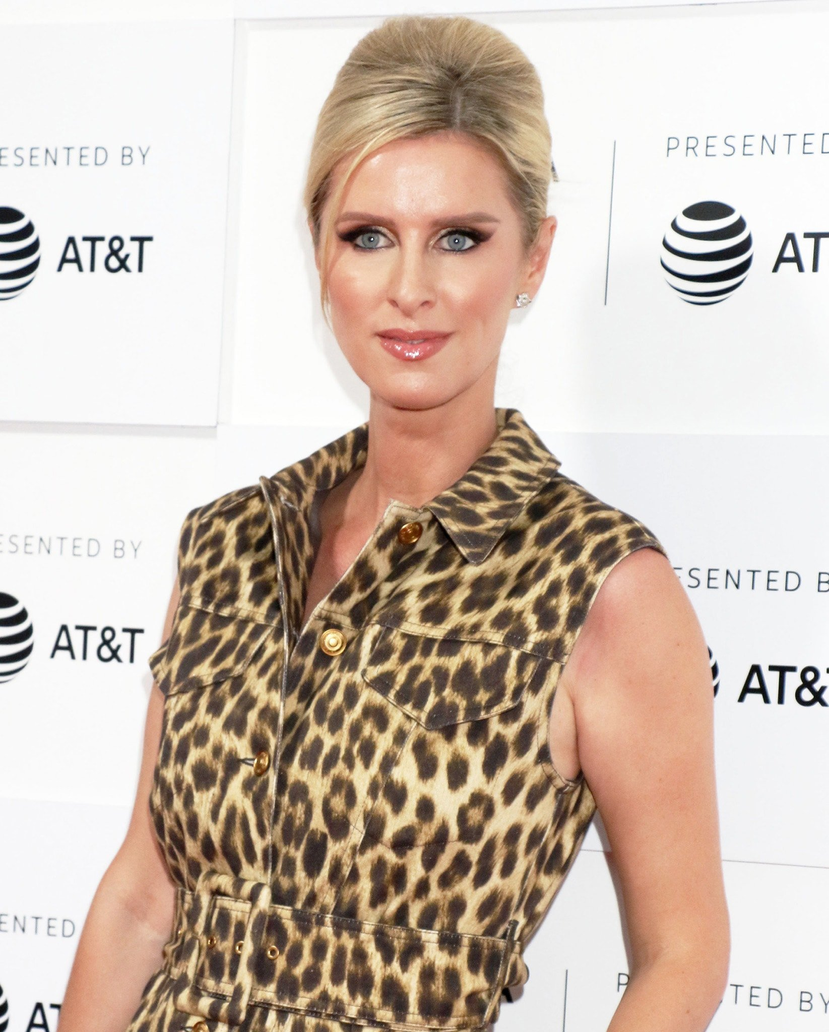 Nicky Hilton styles her blonde tresses into a chic updo and wears smokey eyeshadow with nude lipgloss