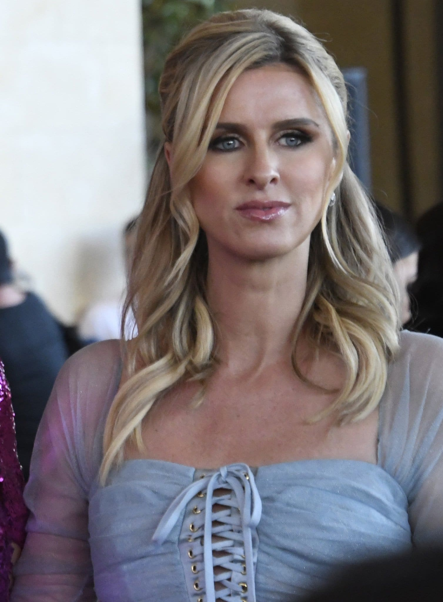 Nicky Hilton goes for a royal look with half-up soft curls and smokey eyeshadow