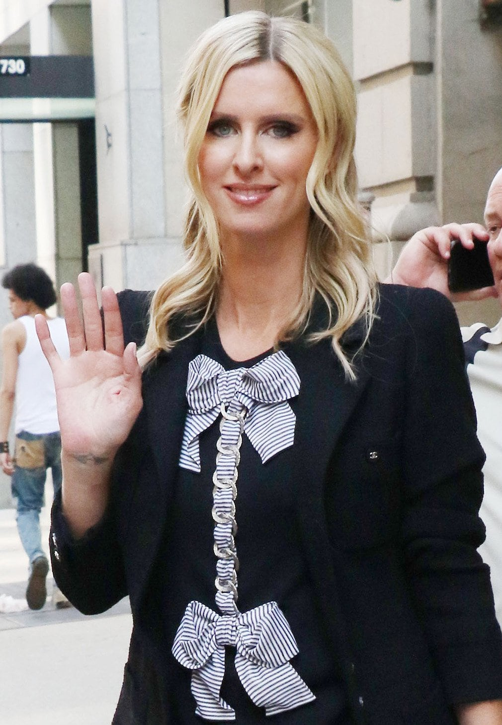 Nicky Hilton wears nude lipgloss and styles her blonde hair in half-up, half-down soft curls