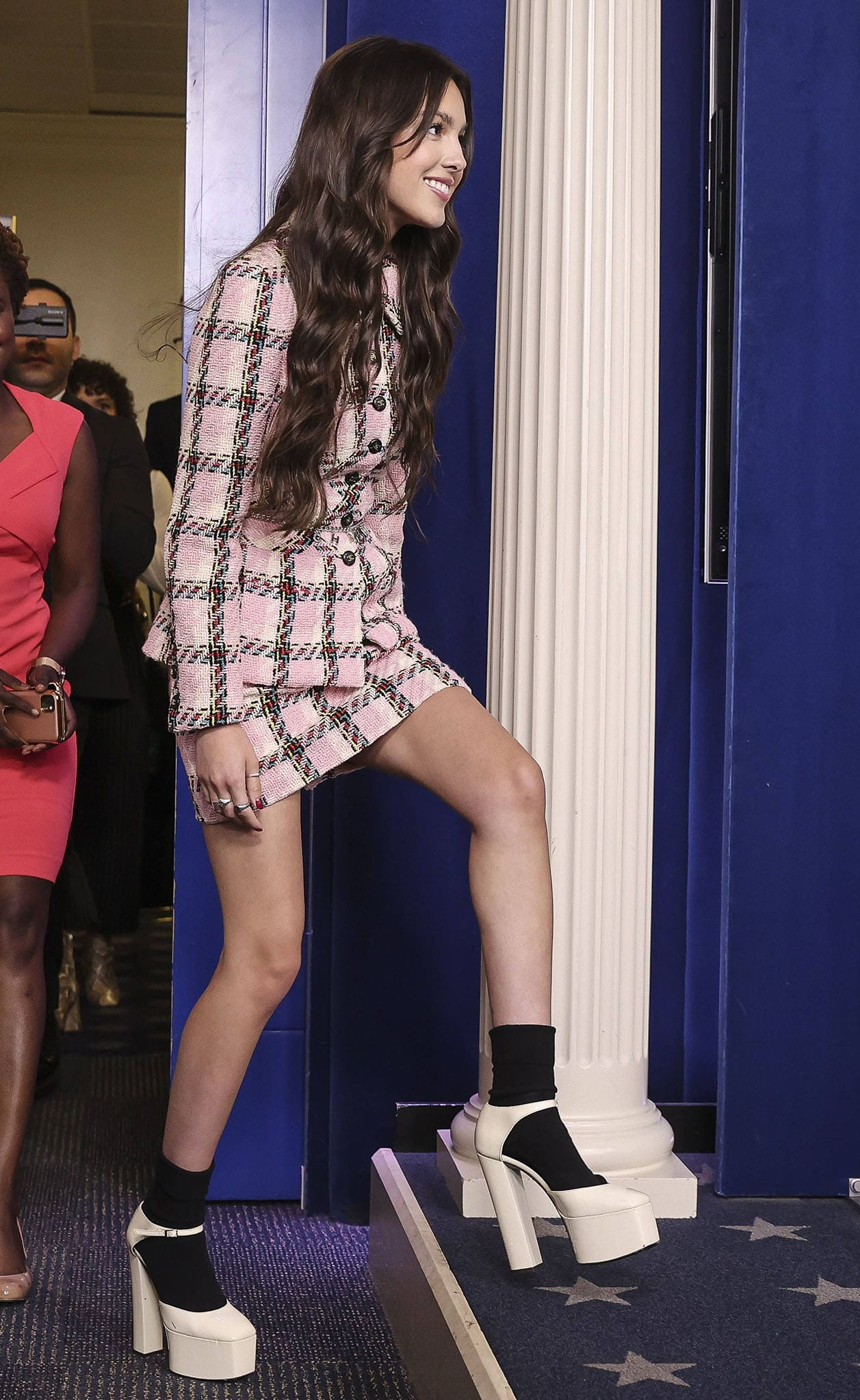 Olivia Rodrigo wears her signature vintage style with a pink plaid tweed set from Chanel
