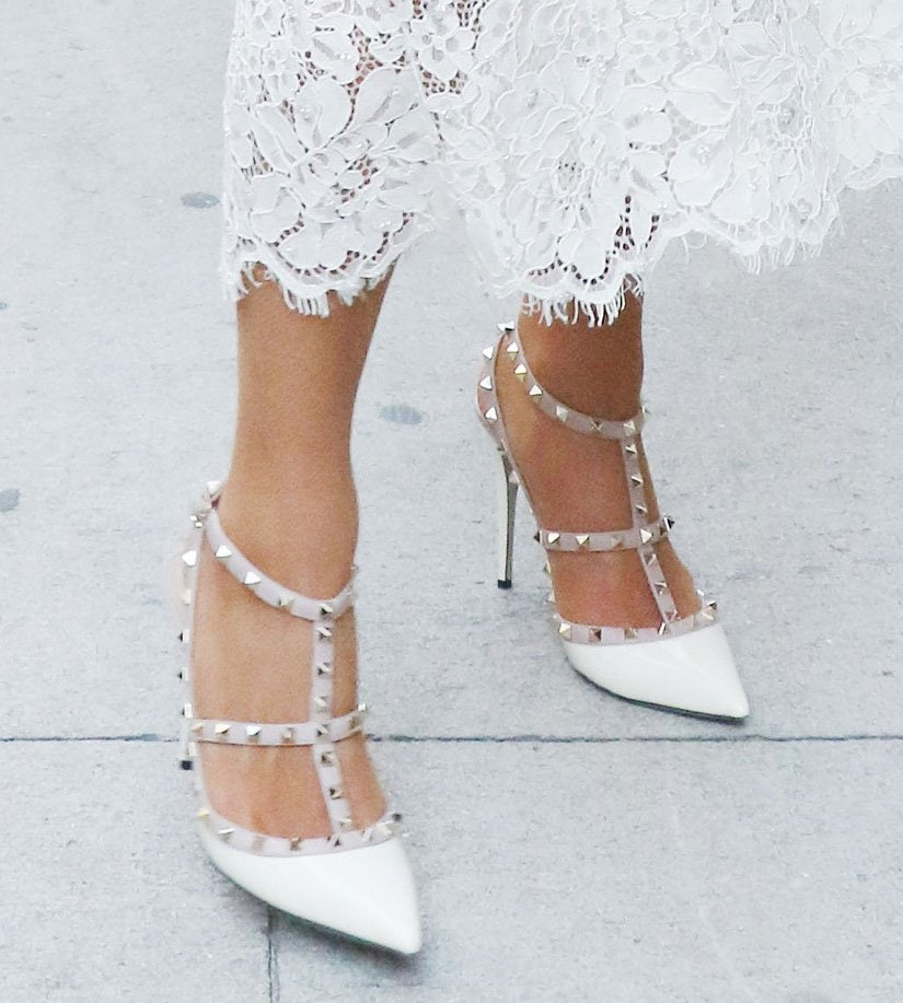 Paris Hilton completes her all-white bridal-inspired look with Valentino Garavani Rockstud white pumps