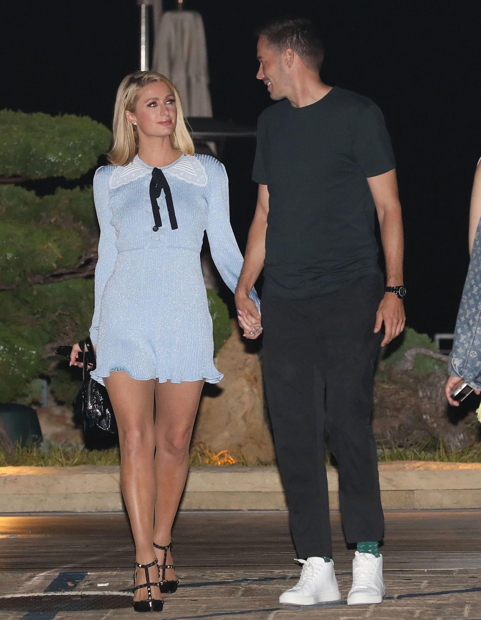 Paris Hilton and fiancé Carter Reum walk hand-in-hand while leaving Nobu Malibu on July 4, 2021