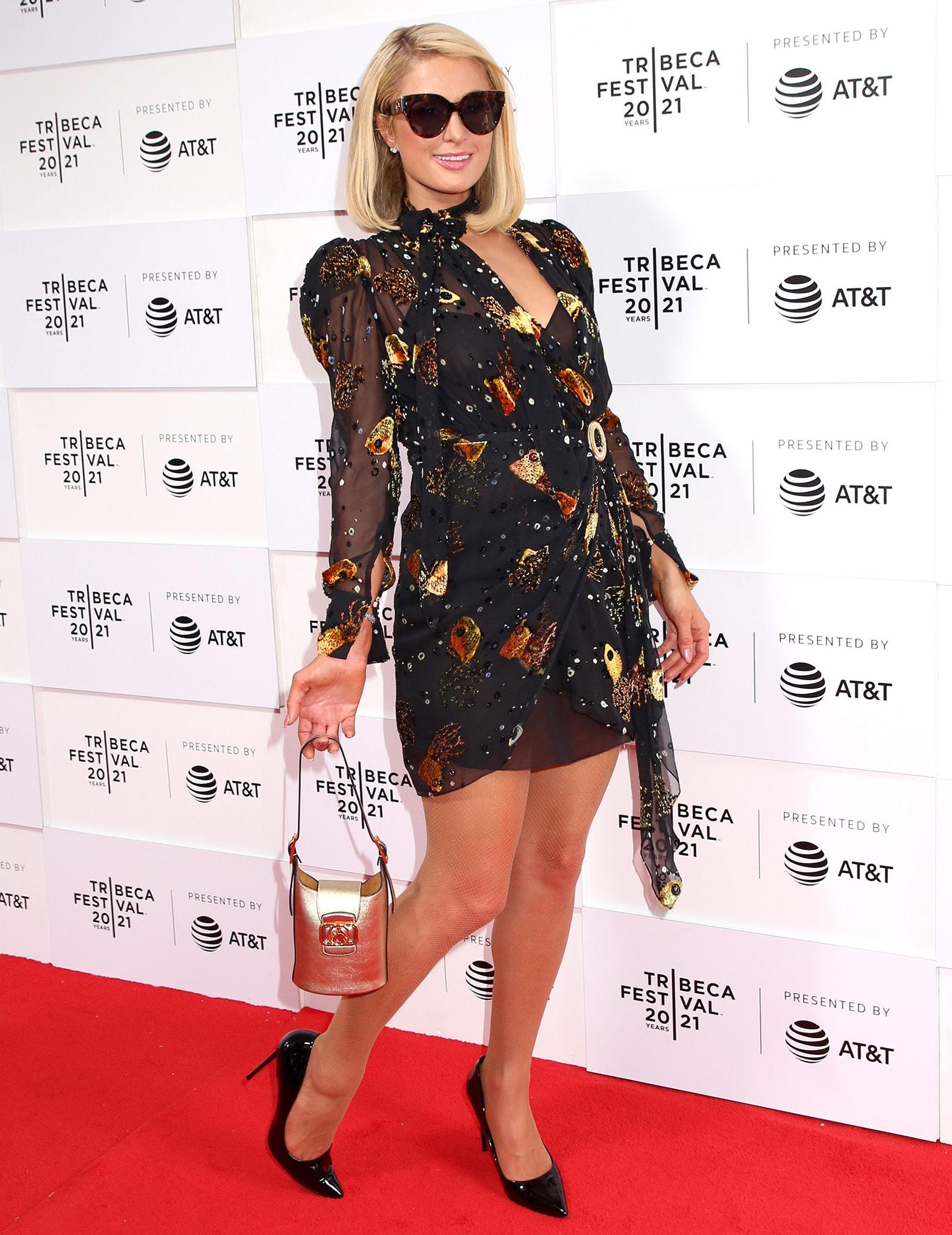 Paris Hilton wows in her Lanvin sheer black embellished wrap mini dress