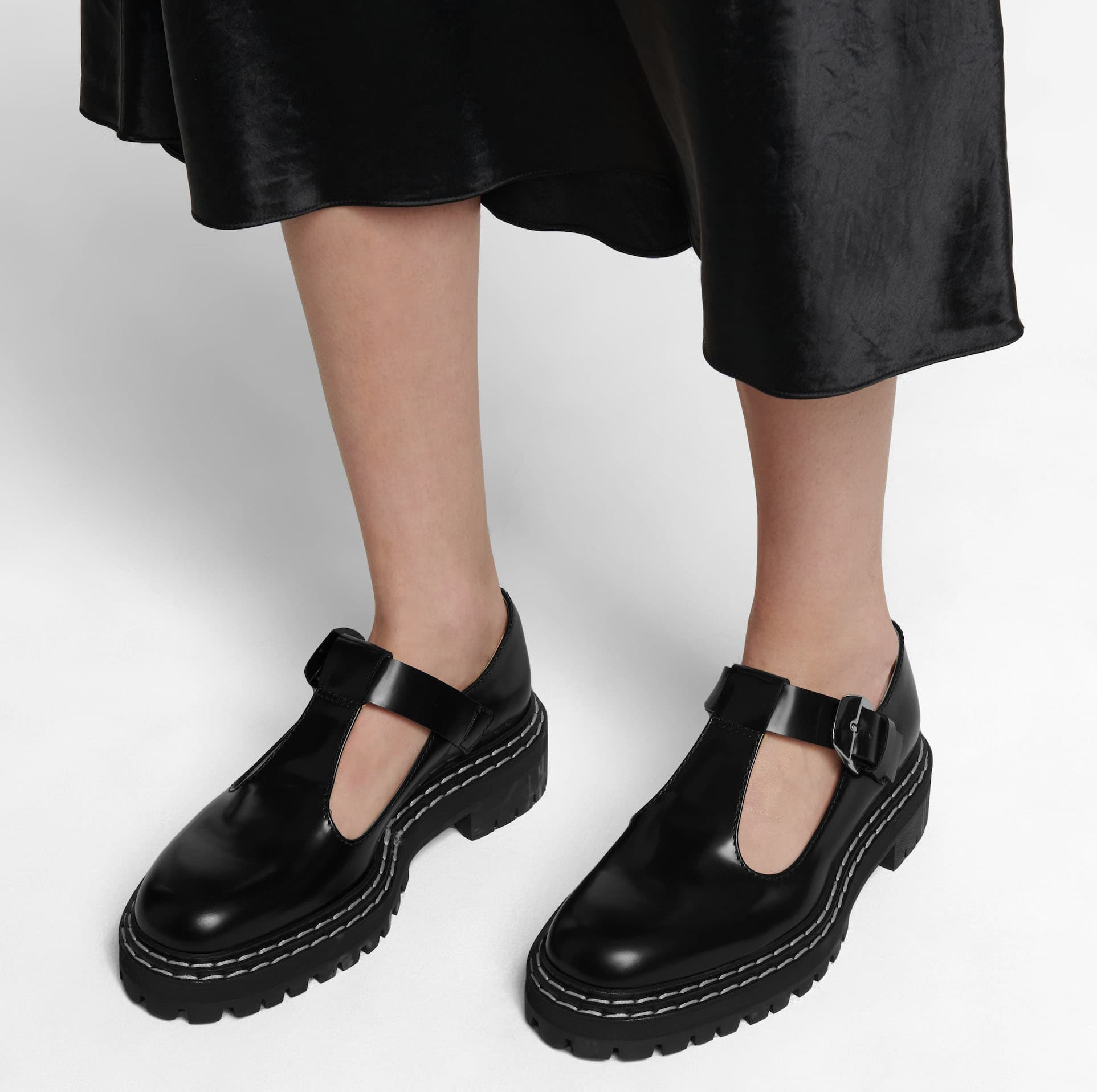 These Proenza Schouler Mary Janes feature wide straps and chunky lug soles