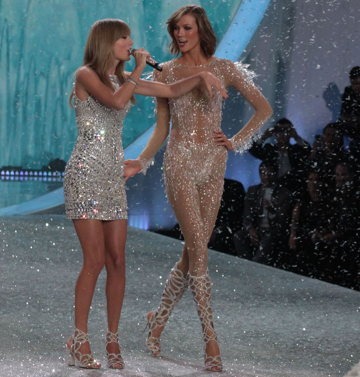 Singer Taylor Swift (L) performs and model Karlie Kloss walks the runway at the 2013 Victoria's Secret Fashion Show
