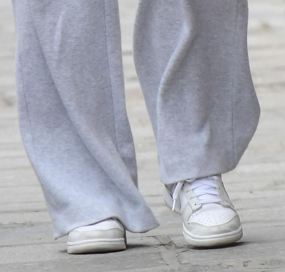 Sophie Turner completes her off-duty look with Nike Dunk Low Photon Dust shoes