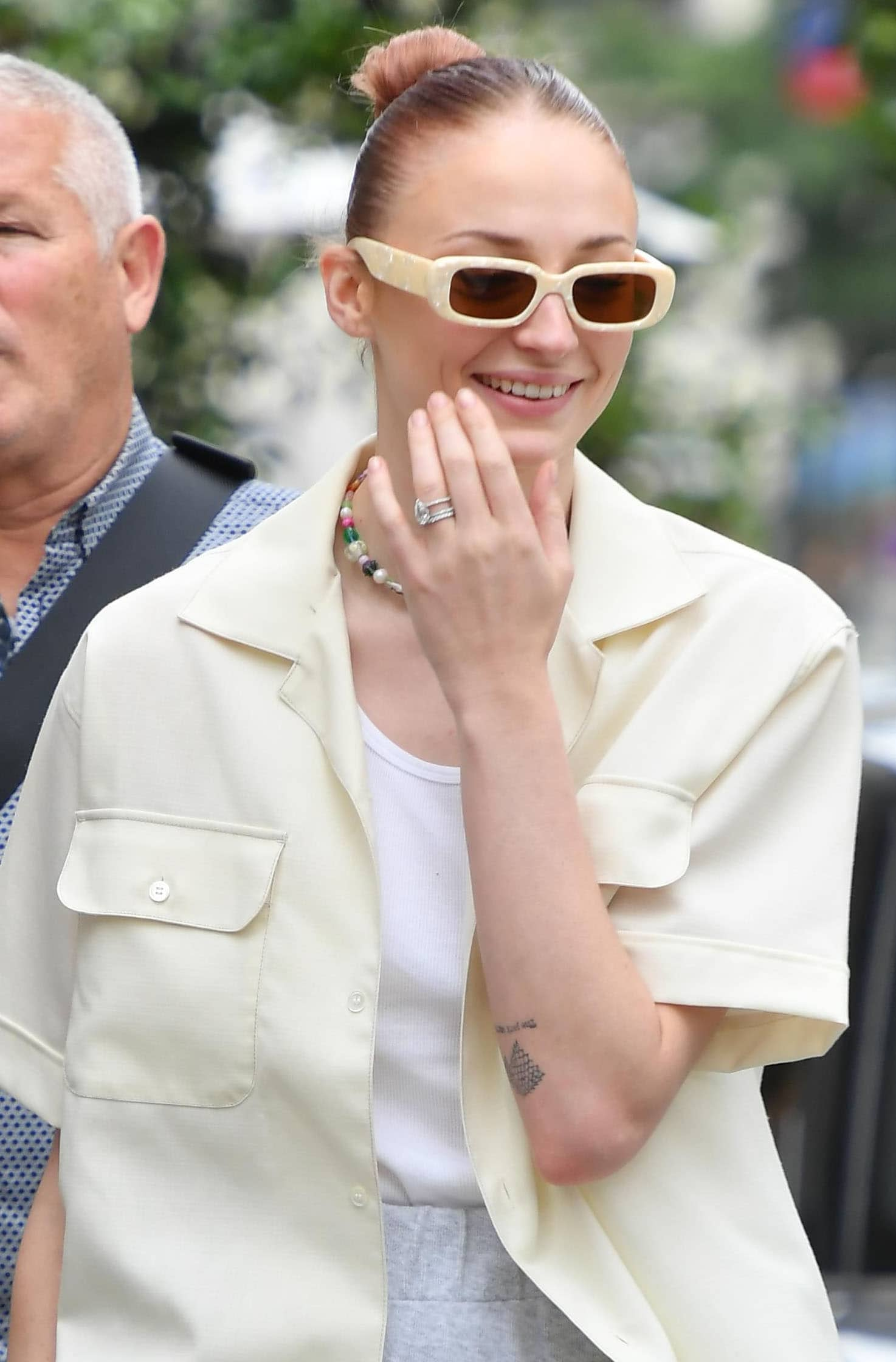 Sophia Turner pulls her newly dyed copper hair into a tight bun and wears minimal makeup with Reality Eyewear sunglasses
