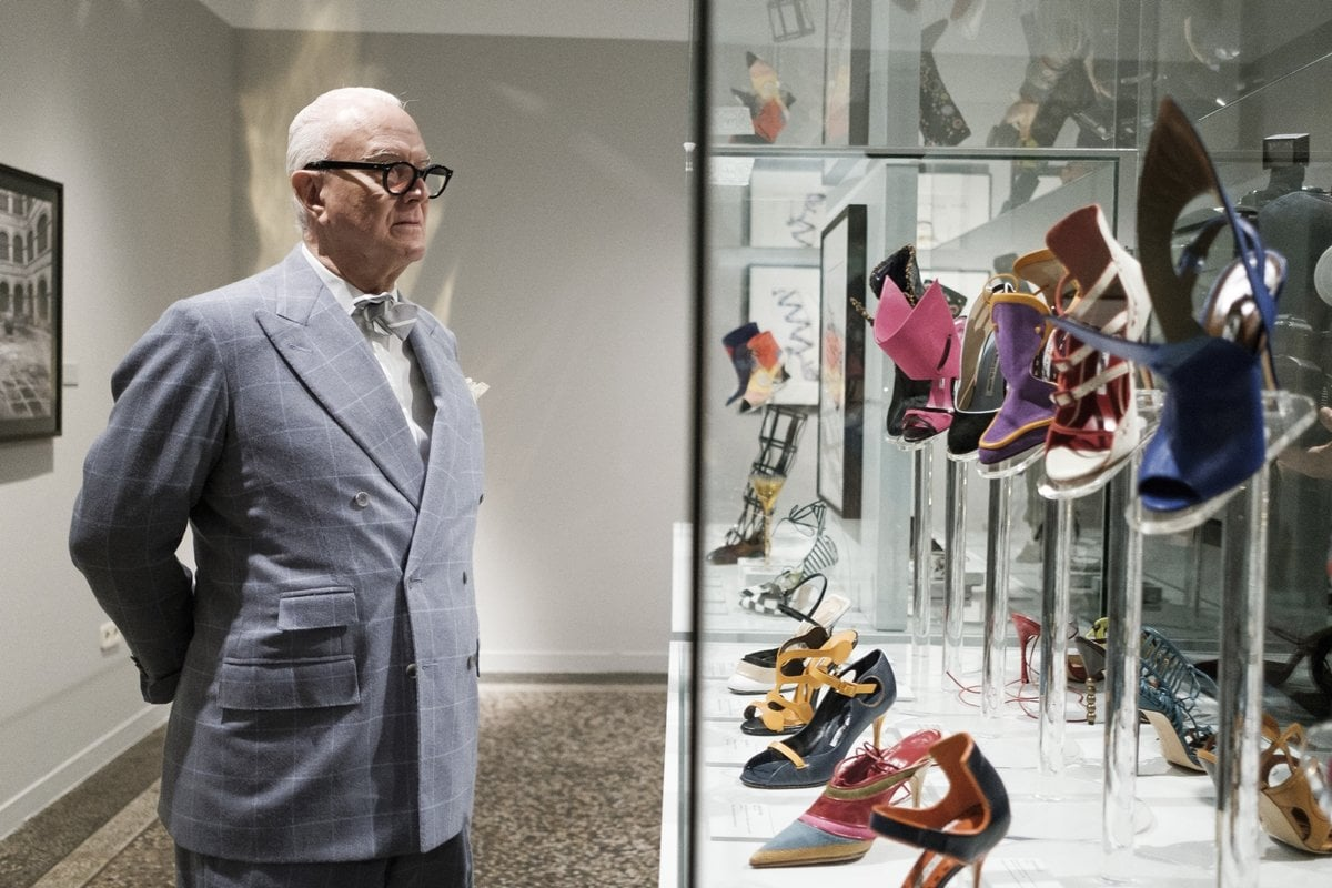 Spanish designer Manolo Blahnik poses during 'The Art of Shoe' exhibition at the National Museum of Decorative Arts in Madrid